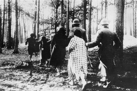 Germans leading Polish women to rape in the forest.